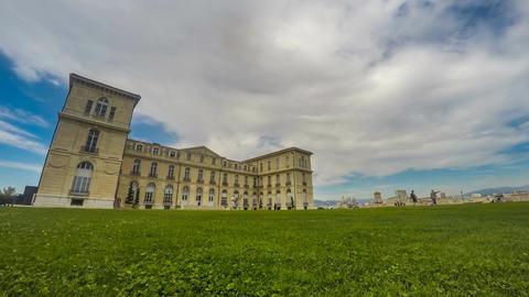Aix-Marseille University building, spacious green lawn near entrance, timelapse Footage