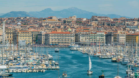 Overlook of Marseille harbor with many sail boats moored densely, cityscape Footage