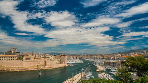Entrance to Marseille Vieux-Port with defensive wall along bank, time-lapse Footage