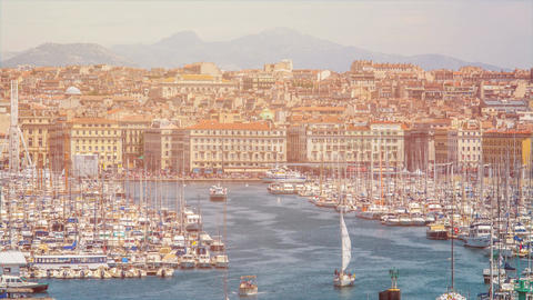 Busy Marseille bay with sail boats docked, many tourists in city, time-lapse Footage