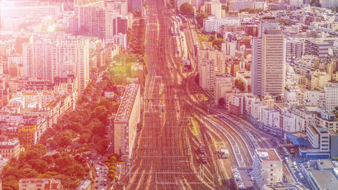 Net of railway tracks in big city, trains running fast, aerial view, timelapse Footage