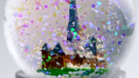 4K Christmas Snow Globe With Colorful Artificial Snowflakes Falling Near Old Footage