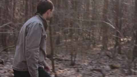 1080p Ungraded: Bearded Man Walks Wildly Through Forest With Bushes And Footage