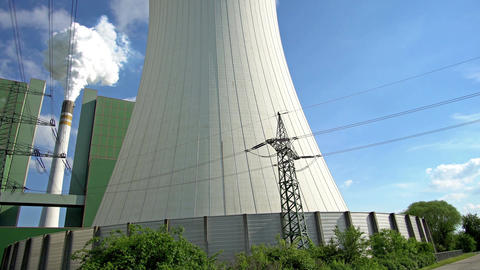 Industrial Cooling Towers Short Pan From Electrical Pylon Handheld Footage