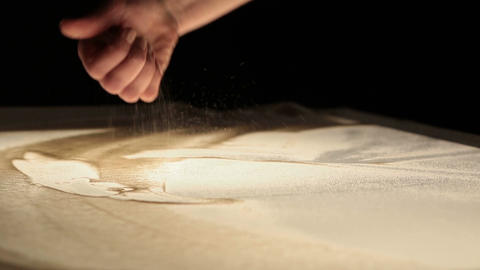 Sand animation. Hands of girl painting in the sand Footage
