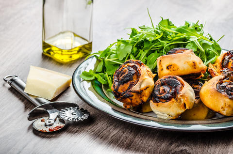 Pizza snails, minipizza with salad and parmagio Photo