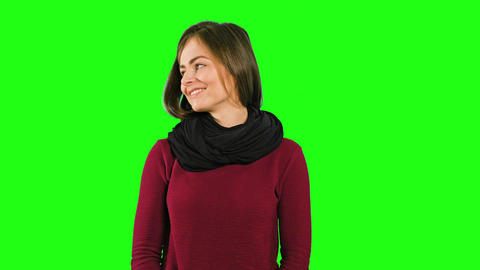 A Friendly Lady Smiling against a Green Background Footage