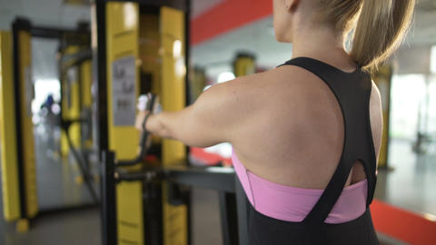 Attractive lady working out in gym, stretching her body and keeping it toned Footage