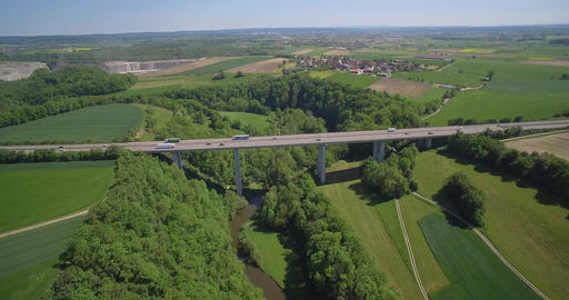 Aerial, Backflight German Autobahn Bridge, Farmland And River Filmmaterial