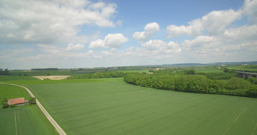 Aerial, High Speed Flight Above High Gras And Farmland, Germany Footage