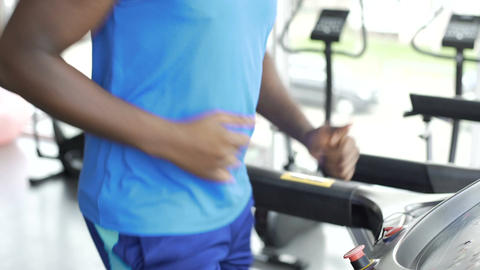 Athletic man running on treadmill at the gym, active lifestyle and sport Footage