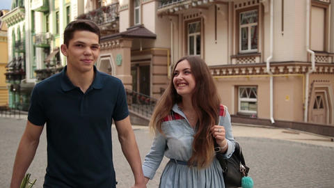 Happy young dating couple in love walking in city Footage