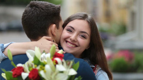 Cheerful young woman embracing man with hands Footage