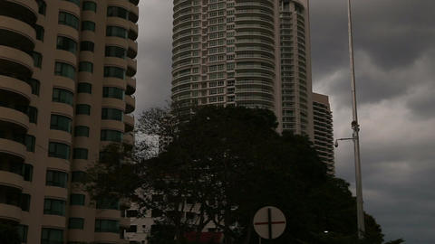 Skyscrapers under Grey Sky and Dark Clouds Footage