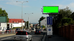 information billboard in the city near road - green screen - security cameras (r Footage