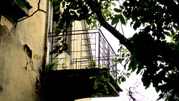 old abandoned house - balcony - nature (trees) - building overgrown with nature Footage