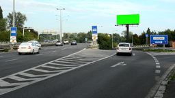 billboard in the city near road (highway) - green screen - passing cars - nature Footage