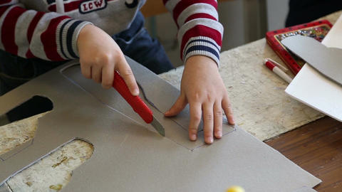 The boy carves model airplane Footage