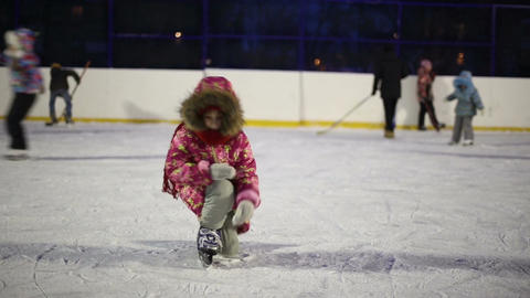 Girl learning to skate and falls on the ice Footage