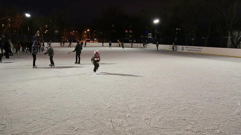 People skate on the outdoor ice rink Footage