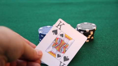 Ace and King placed on stacks of poker chips Live Action