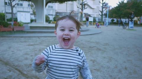 small asian child runs slow motion ビデオ