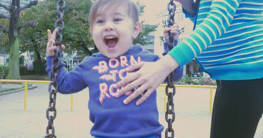 toddler Laughing on the swing with his mother ビデオ