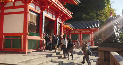 Tourists walk in and out of the temple in Kyoto Footage
