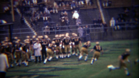 1969: Purdue College football team practice ball snapping drills Footage