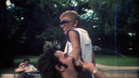 1969: Pixie haircut partner arrives for lunch at outdoor dining area Footage