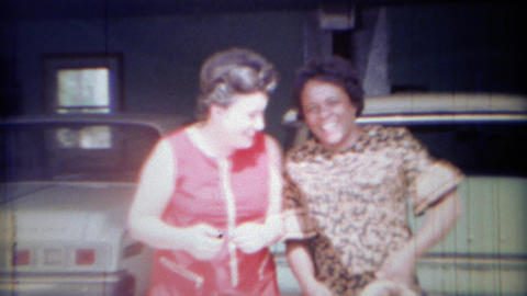 1969: African and caucasian women are neighbor friends Footage