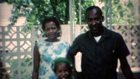 1969: African family reunion outdoor summer patio Footage