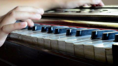 A close shot of playing harmonium Footage
