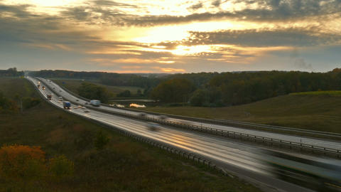 cars on highway road at sunset, zoom in timelapse Footage
