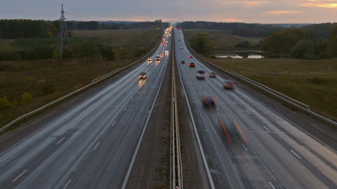 cars on highway road in dusk, zoom in timelapse Footage