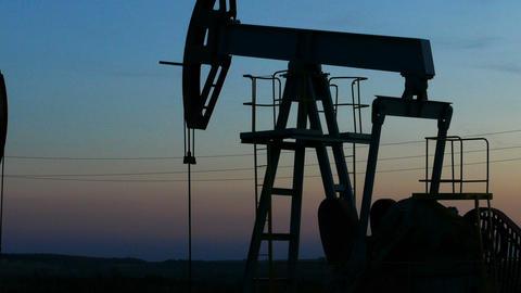 working oil pumps silhouette in dusk, zoom in Footage