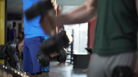 Strong men working out together, training in gym to be fit and healthy, fitness Footage