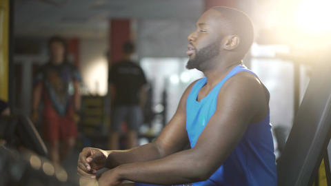 Handsome African American man tired after active training in gym, lifestyle Footage