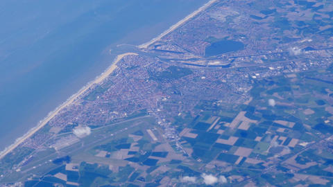 Aerial view of farmland area, cities and sea water landscape from airplane Footage