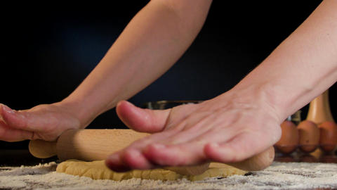 Female Hands Rolling Out Dough on the Table Footage