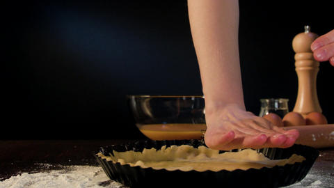 Female Hands Placing Dough in a Baking Pan Footage