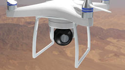 Drone with camera shooting over desert terrain aerials Footage