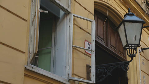 View on open window of old building and streetlight, hospitality and amity Footage