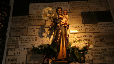 Statue of Virgin with the child inside Stone Gate, religious place, Zagreb Footage