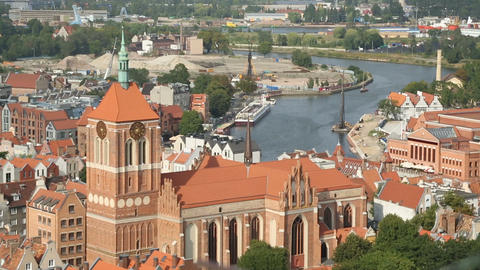 Gdansk aerial cityscape, gothic architecture of medieval Saint Johns Church Live Action