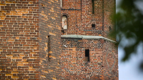 High brick wall of medieval fortress, ancient fortification for city protection Footage