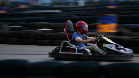 Active man enjoying speed at kart racing, having fun at karting club, male hobby Footage
