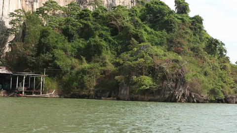 View of Moorage at Foot of Rocky Island with Mangrove Trees Footage
