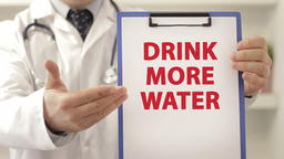 Doctor advice patient to drink more water Footage