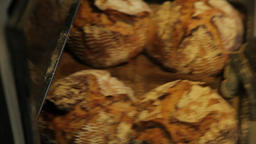 Ejecting of the ready bread from the oven Image